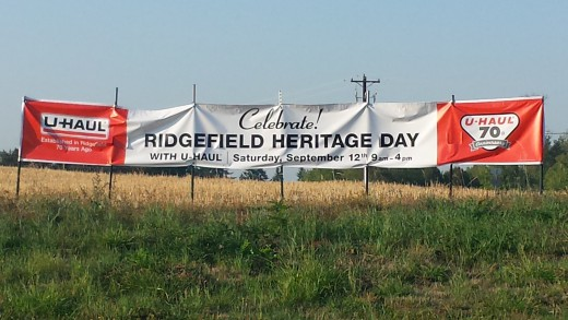 A banner near Ridgefield announcing the celebration of Ridgefield Heritage Day and U-Haul Company's 70th anniversary.