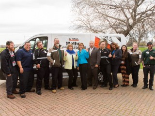 Roseville leaders and U-Haul Team Members pose in front of a U-Haul moving van to become #uhaulfamous.