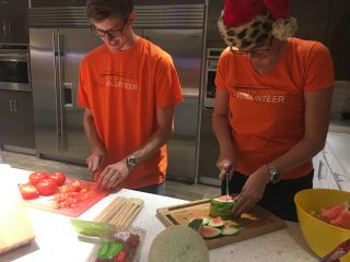 U-Haul Team Members preparing meals at Ronald McDonald House