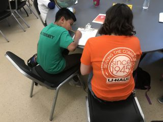 U-Haul Team Member Helping Student with Homework