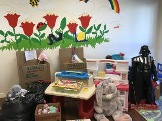 U-Haul Provides Toys for the Phoenix Starfish Place kids room