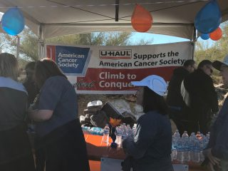 U-Haul booth at the Climb to Conquer Cancer mountain-top party