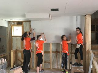 U-Haul Team Members volunteer with Habitat for Humanity