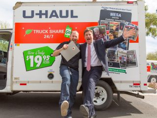 Stuart Shoen and Phoenix Mayor Greg Stanton pose for a U-Haul Famous photo during U-Haul Day festivities at the state capitol