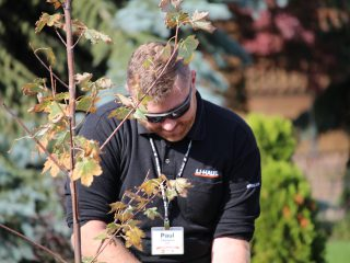 U-Haul Team Member Paul Chalmers planting tree