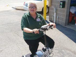 Cathy Engle with motor scooter